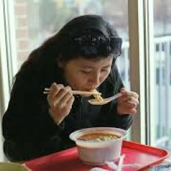 Photo of person eating soup