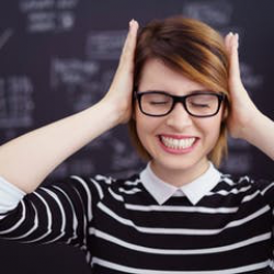 Photo of person with hands over ears